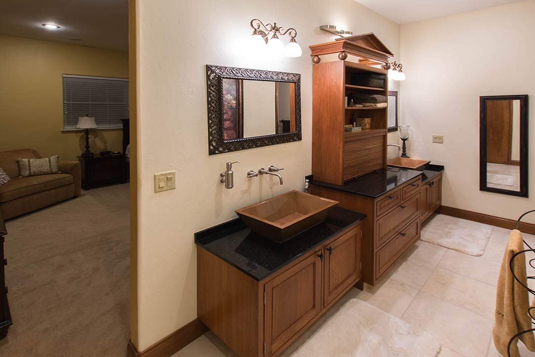master bath with copper sinks